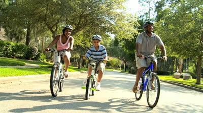 stock-footage-young-african-american-family-exercising-together-out-cycling